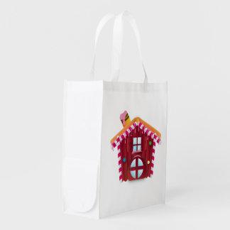 Casa del caramelo en la colina bolsas de la compra