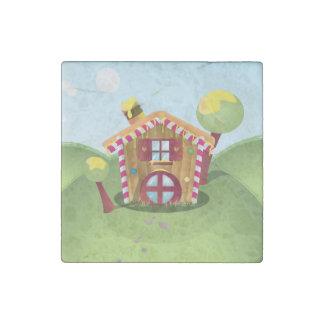 Casa del caramelo en la colina imán de piedra