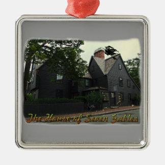 Casa del ornamento de siete aguilones adorno navideño cuadrado de metal