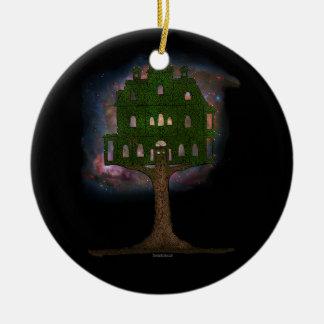 Casa en el árbol del cosmos adorno redondo de cerámica