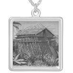 Casa en el pueblo de Arfak de Memiwa, Nueva Guinea Colgantes
