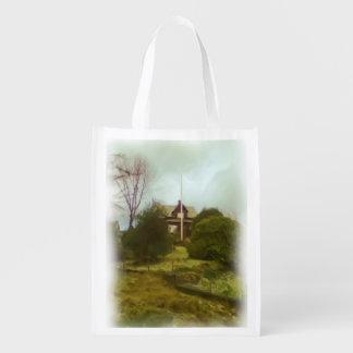 Casa en una pequeña colina bolsas reutilizables