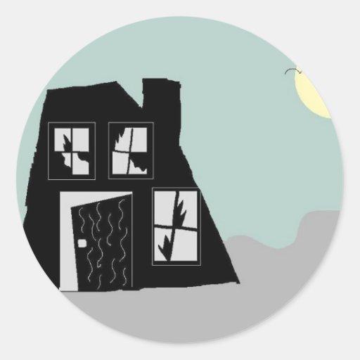 Casa encantada pegatina redonda