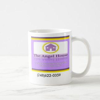 Casa que hace frente logotipo del ángel de la cas tazas de café