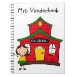 Casa roja de la escuela con el cuaderno del profes