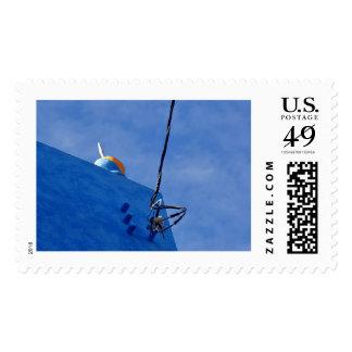 Casa y cielo limpiados con esponja azul timbres postales