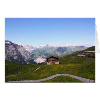 Casa y montañas suizas tarjeta de felicitación