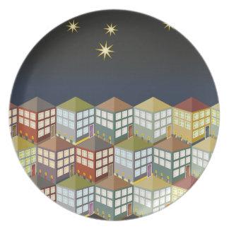 Casas de las casas en la placa de la noche plato para fiesta
