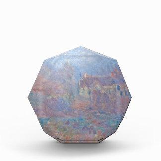 Casas en Falaise en la niebla de Claude Monet