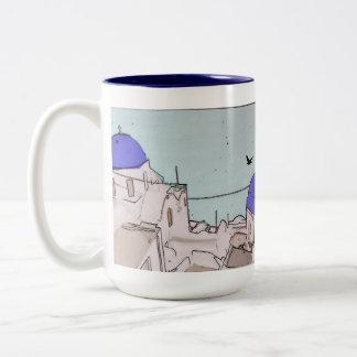 Casas griegas blancas azules de las memorias del taza de dos tonos