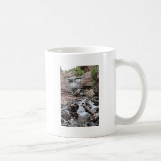 Cascada de la cala del heno taza de café
