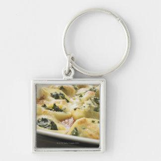 Cáscaras cocidas de las pastas con el relleno de l llavero personalizado