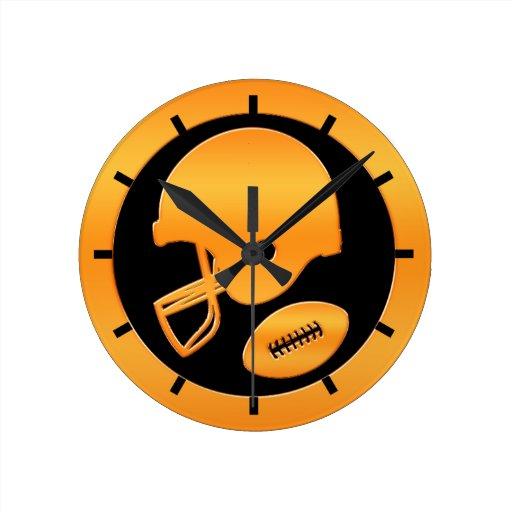 Casco de fútbol americano y bola del oro reloj de pared
