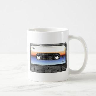 Casete de la salida del sol del océano tazas de café