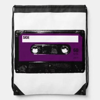 Casete púrpura de la etiqueta mochila