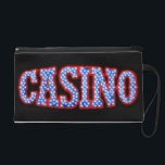 "Casino in Red White &amp; Blue Wristlet Purse<br><div class=""desc"">A cool photograph of a Casino neon sign in red,  white and blue!  Copyright &#169; 2009 Karin Hildebrand Lau.</div>"
