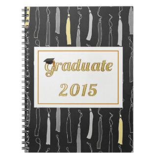Casquillo graduado del oro con el fondo 2015 de la libreta