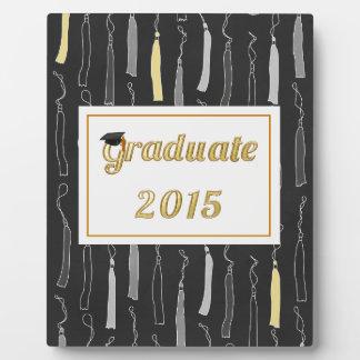 Casquillo graduado del oro con el fondo 2015 de la placa de plastico