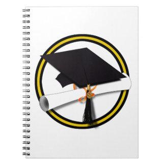Casquillo y diploma - oro y colores negros del libros de apuntes con espiral
