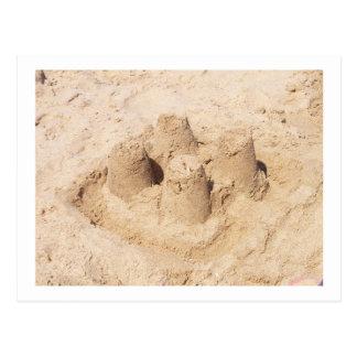 castillo de arena postal