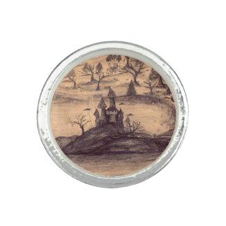 Castillo que dibuja alrededor del anillo de plata