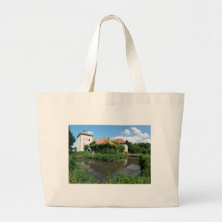 Castle surrounded by moats into federations large tote bag