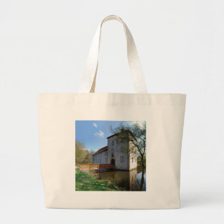 Castle surrounded by moats large tote bag