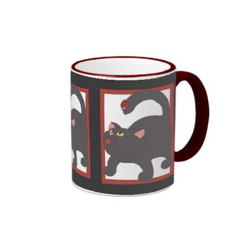 Cat and ladybug coffee mugs