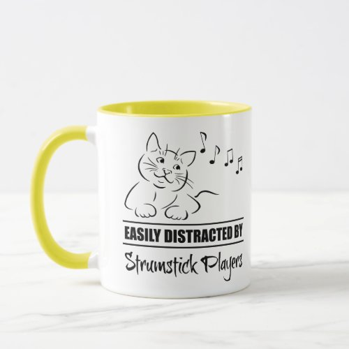 Curious Cartoon Cat Easily Distracted by Strumstick Players Music Notes Coffee Mug