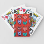 Cat faces on red card deck