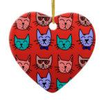 Cat faces on red ceramic ornament