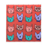 Cat faces on red memo pad