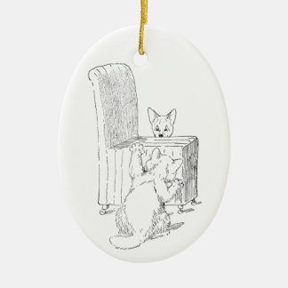 Cat Gives Dog a Fright Ceramic Ornament