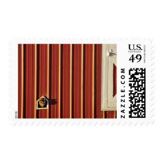 Cat has own door at Bigfork Montana barn Postage
