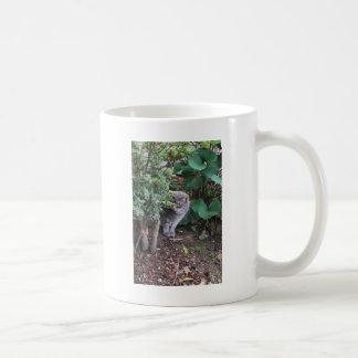 cat in a garden coffee mug