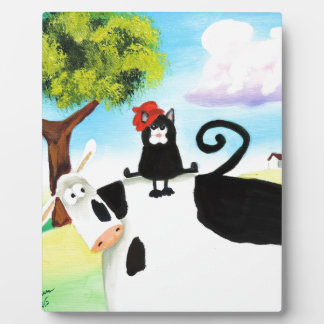 cat in a hat on a cow plaque
