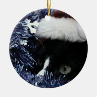 Cat in santa hat hiding in blue tinsel peering out Double-Sided ceramic round christmas ornament