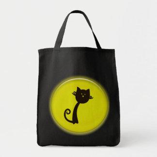 cat in yellow circle bag