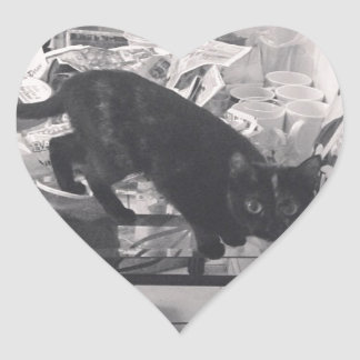 Cat is caught guilty heart sticker