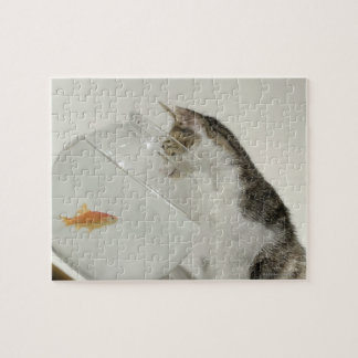 Cat looking at fish in fishbowl jigsaw puzzle