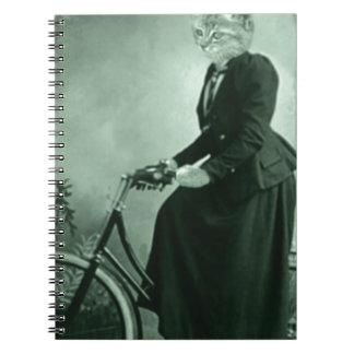 Cat on a bike note book