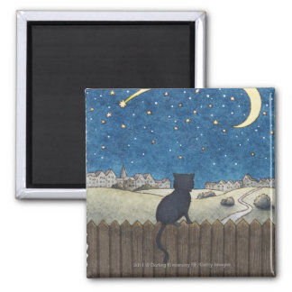 Cat on a fence looking at night sky above city 2 inch square magnet