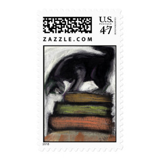 Cat on a stack of books postage stamp