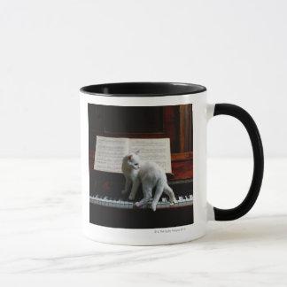 Cat on piano mug