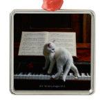Cat on piano ornament