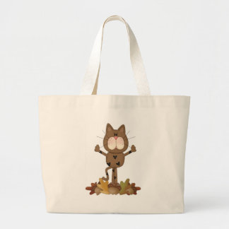 Cat playing in leaves bag