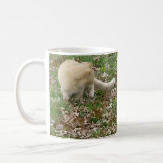 Cat Playing in the Leaves Coffee Mug