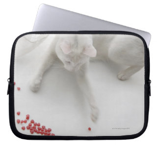 Cat playing with heart shaped candy laptop sleeve