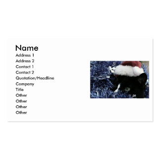Cat ready to pounce behind blue tinsel, faded tint business card templates