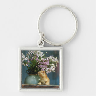 Cat sitting besides flower vase on window sill Silver-Colored square keychain